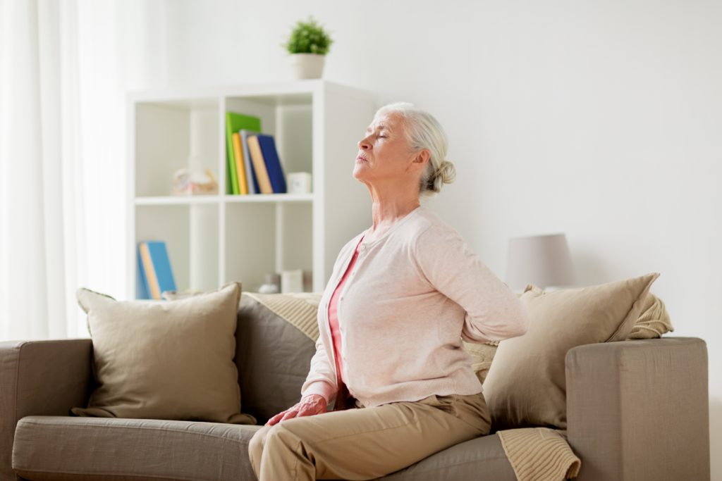 senior woman suffering from pain in back at home