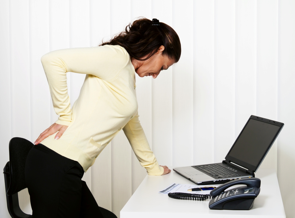 Image of woman with back pain from a bulging disc