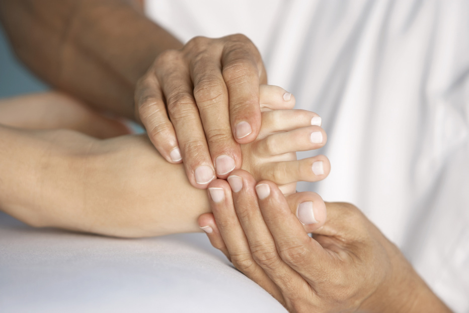 Image of woman with foot pain problems being examined