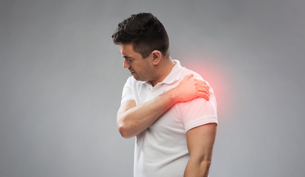 unhappy man suffering from Shoulder Tendinitis