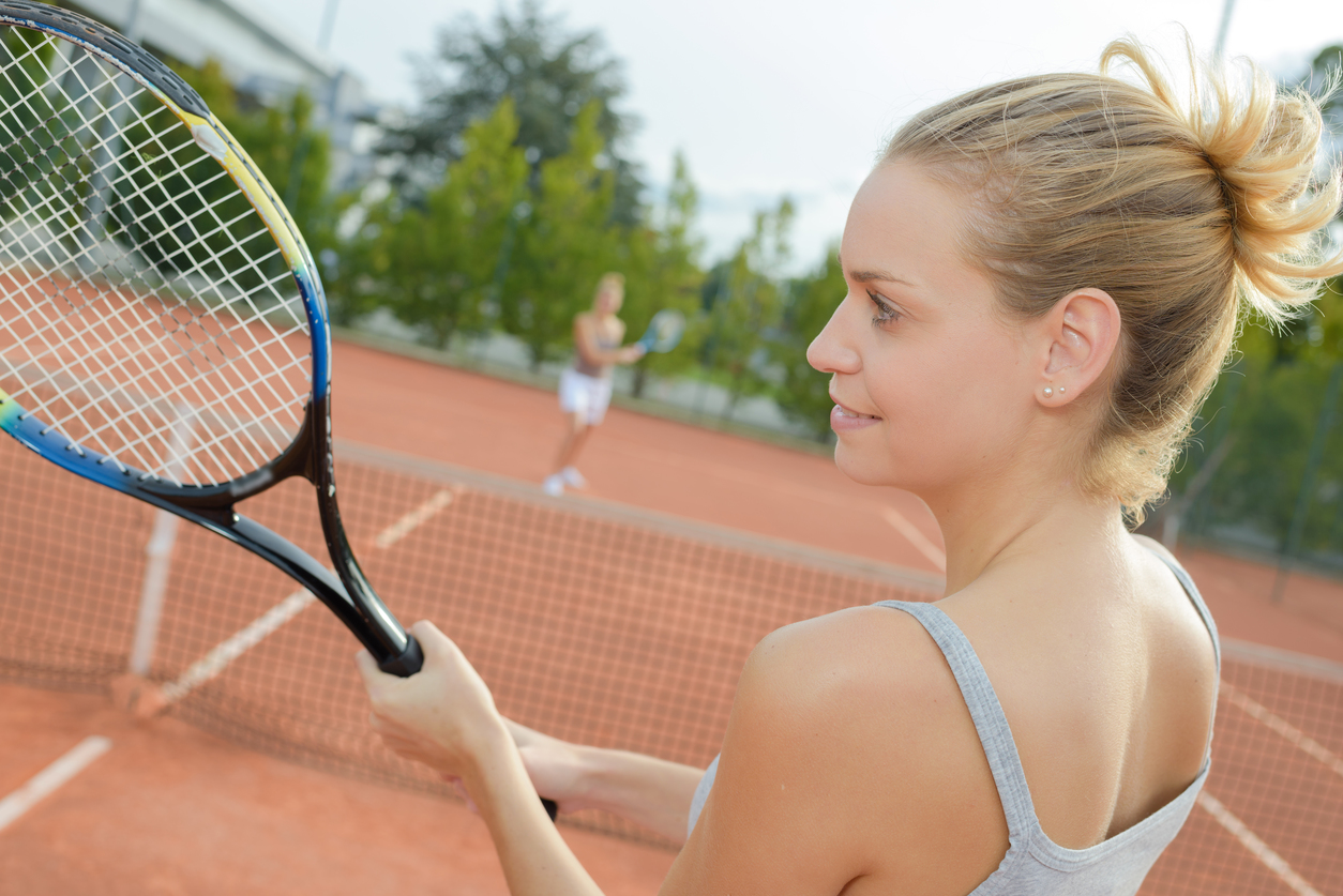 beautiful woman playing in tennis outdoors